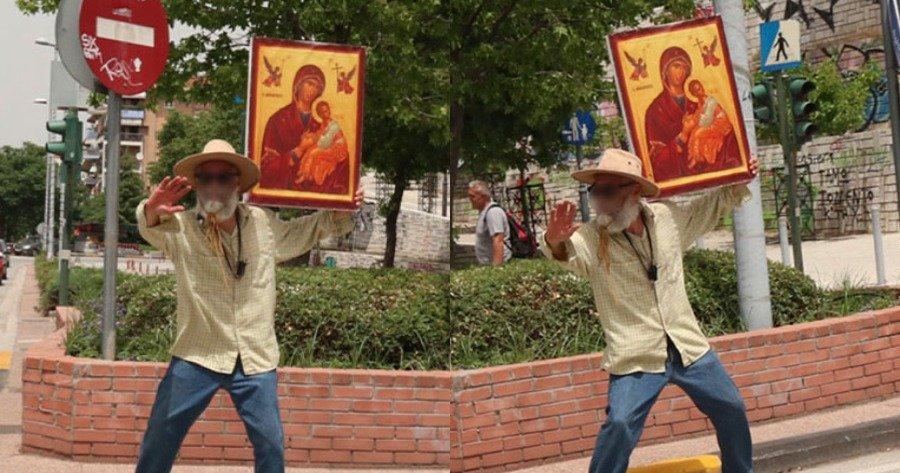 Άντρας βγήκε στους δρόμους της Λάρισας, κρατώντας την εικόνα της Παναγίας